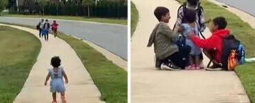 Bambina corre ad abbracciare i fratelli che tornano da scuola